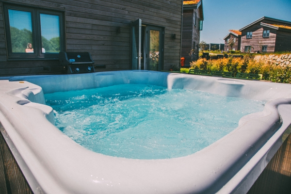 log cabins with hot tubs in the south west
