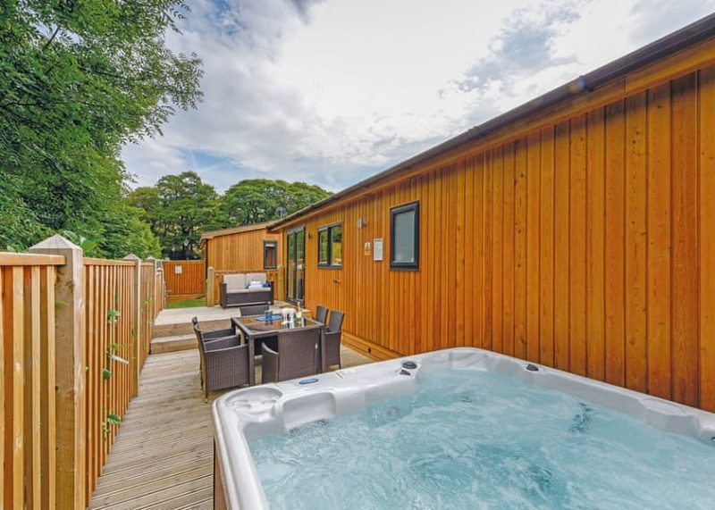 log cabin with hot tub near manchester