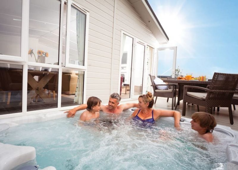 log cabins with hot tubs south west